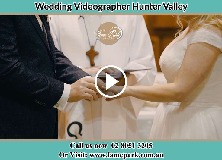 Groom Putting Ring To the Bride Hunter Valley